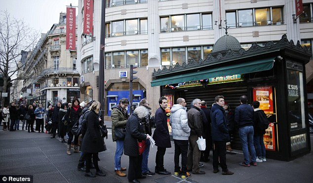Parisians line up to buy the first issue of Charlie Hebdo since the deadly attack on their offices last week.