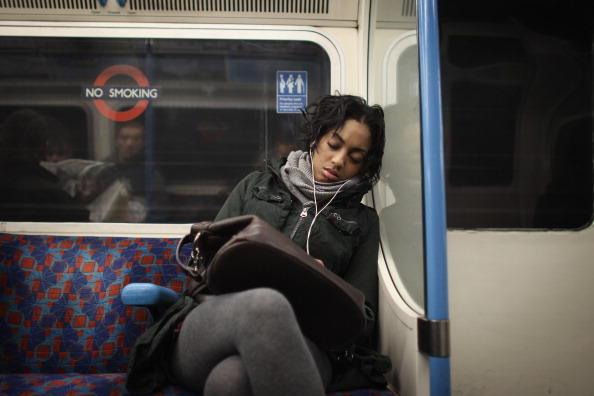 Woman sleeping on train